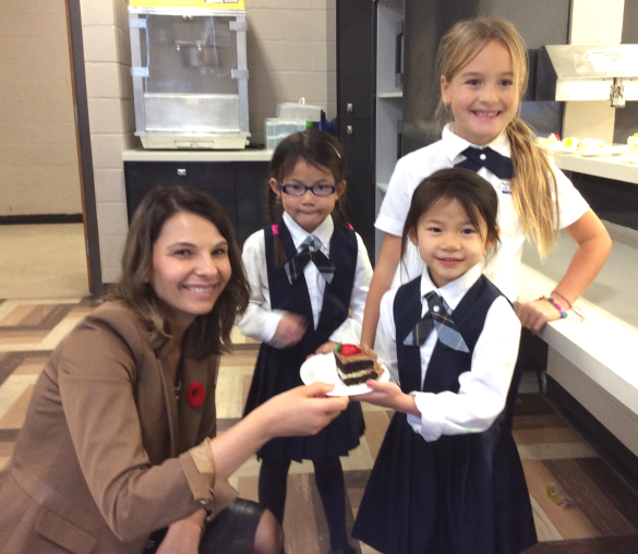 , the students were treated to cake and ice cream – a special St. Charles Feast Day treat